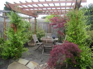 Seating area, ready for Summer entertaining!  Fragrant vines will cover this pergola in no time....